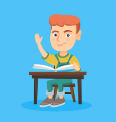 pupil raising hand while sitting at the desk vector image