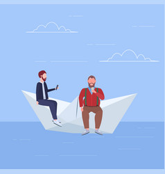 two men floating on paper boat guys using gadgets vector image