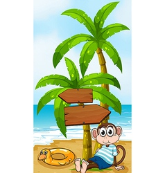 A monkey sitting below the wooden arrowboard vector