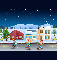Happy kids running in the snowy village vector
