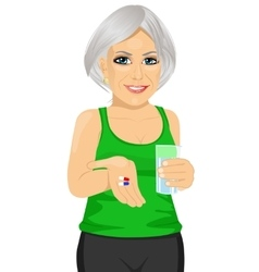 Elderly woman holding glass of water taking pills vector