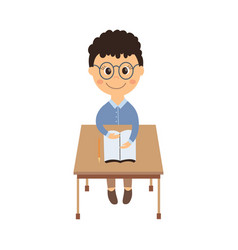 Flat schoolboy sitting at desk isolated vector