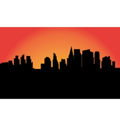 Silhouettte of the city at sunrise vector