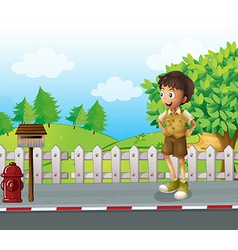 A boy at the road near the wooden mailbox vector