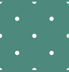 Tile pattern with small white polka dots on green vector