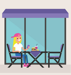 Young blonde girl sitting on the restaurant vector