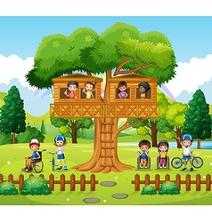 Children playing at the treehouse in the park vector image