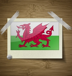 Flags Wales at frame on wooden texture vector image
