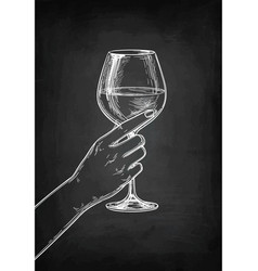 Hand holding a glass wine vector