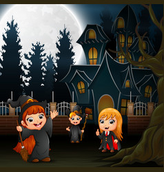 Halloween kids with scary house on the full moon b vector