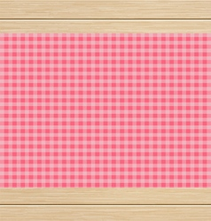 Pink Checkered Tablecloth on White Oak Wooden vector