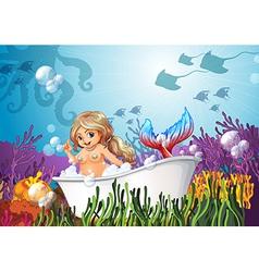 A bathtub under the sea with a mermaid vector