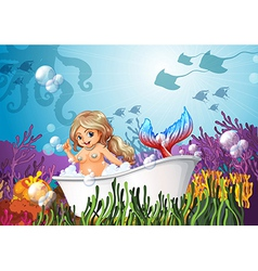 A bathtub under the sea with mermaid vector