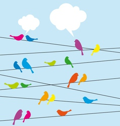 Birds sitting on wire vector