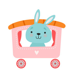 Cheerful red cheeked hare driving toy wheeled vector