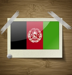 Flags Afghanistan at frame on wooden texture vector image