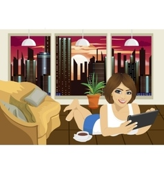 Young woman reading ebook at home lying on floor vector