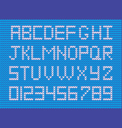 set of white knitted alphabet and numerals on blu vector image