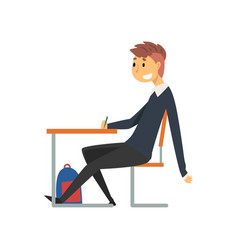 Male student sitting and writing at desk in vector