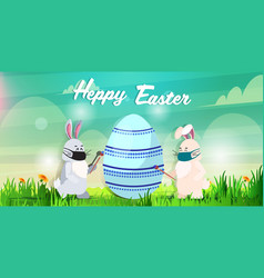 Rabbits in masks drawing on egg happy easter bunny vector