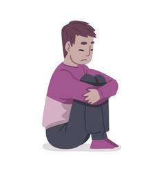Depressed guy sitting on floor hugging his knees vector