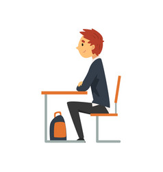 Diligent student sitting at desk in classroom vector