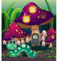 A worm near the mushroom house vector image