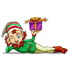 A happy elf holding a gift vector image vector image