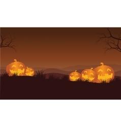 Silhouette of Halloween orange pumpkins in hills vector image vector image
