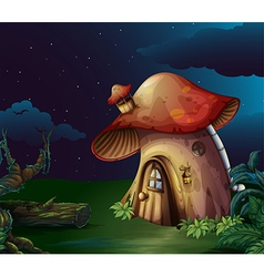 A big mushroom house at the forest vector image