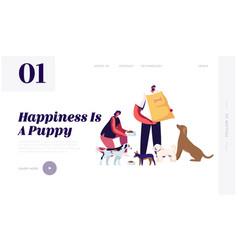 friendly volunteer feeding dogs in animal shelter vector image