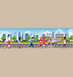 Parents with children crossing crosswalk pupils vector