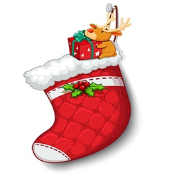 A deer hugging the gift above the red sock vector image