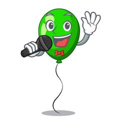 Singing green ballon with cartoon ribbons vector