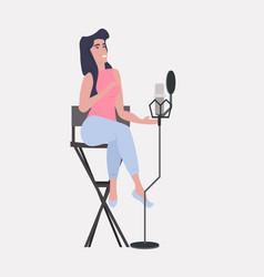 Woman blogger recording music video blog in studio vector