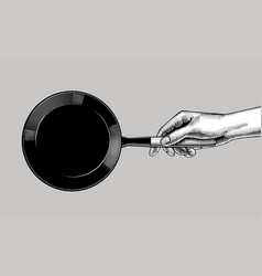 female hand with a black frying pan vector image