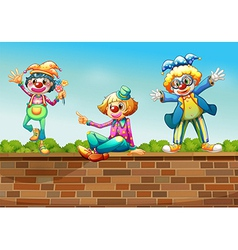 Three clowns above the wall vector