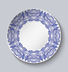 Plate decorated with blue floral patterns in the vector