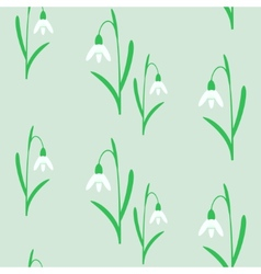 Seamless background with snowdrops vector
