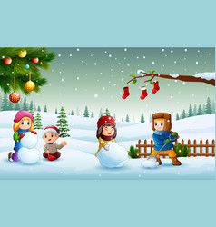 happy kids playing on the snow and making a snowma vector image