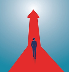 Businessman walking on red arrow vector image