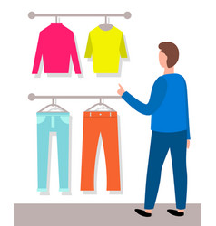 Man is looking on shirts and pants male buyer and vector