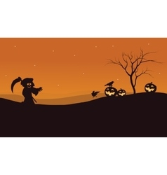 Silhouette of Halloween warlock and pumpkins vector image