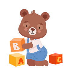 Cheerful bear character wearing playsuit sitting vector