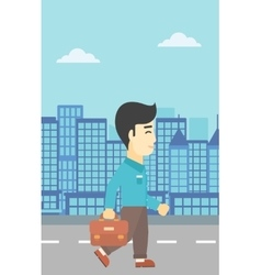 Successful businessman walking with briefcase vector