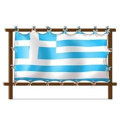 The flag of Greece attached to the wooden frame vector