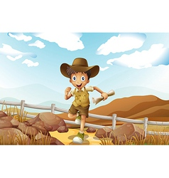 A young explorer running with a map in his hand vector image