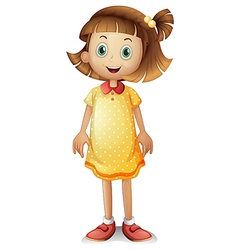 A cute young girl wearing yellow polka dress vector