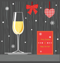 glass of champagne on tray and christmas card vector image