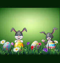two happy rabbit cartoons with easter eggs in a fi vector image
